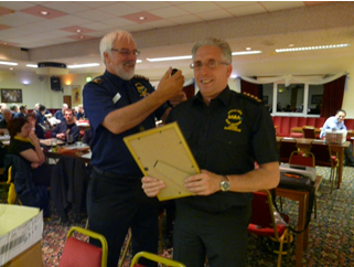 Alan passing on to Chris the Executive Chairman's epaulets